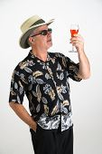 Tourist Holding Tropical Drink poster