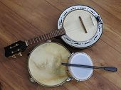Close-up Of Three Brazilian Musical Instruments: Samba Banjo (strings), Pandeiro (tambourine) And Ta poster
