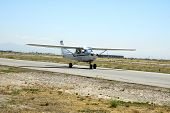 picture of cessna  - A Cessna 152 taxis toward the runway for takeoff - JPG