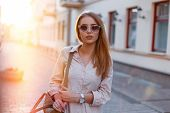 Stylish Young Hipster Woman In Stylish Sunglasses In A Trendy White Dress With A Fashionable Brown L poster