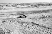 Race In Sand Desert. Car Suv Overcomes Sand Dunes Obstacles. Competition Racing Challenge Desert. Ca poster