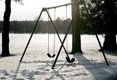 stock photo of swingset  - silhouette of an abandoned swingset in the park - JPG