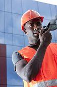 Construction worker speaking on Walkie-Talkie