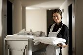 stock photo of maids  - Maid with housekeeping cart - JPG