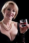 Happy Mature Woman With Drink