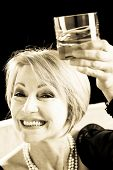 Happy Mature Woman With Drink, sepia toned image