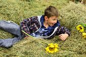 Just Relax. Little Child Relax In Hayloft. Little Child Lying In Hayloft In Countryside. A Wonderful poster