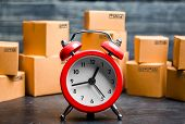 Cardboard Boxes And Red Alarm Clock. Time Of Delivery. Limited Supply, Shortage Of Goods In Stock, H poster