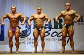 MOSCOW - APRIL 16: Mityushin Yuri, Tronov Alexey, Petrov Alexey compete at Open Cup of bodybuilding