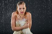 stock photo of jupe  - beautiful girl wearing in dress with corset freezes in rain and tries to keep warm - JPG