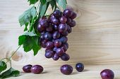 Fresh Grapes Food Closeup. Healthy Food. Vegetarian Food. Nutritious Food. Grapes On A Wooden Backgr poster