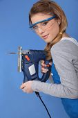 Attractive woman with band-saw