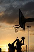 Basketball Players At The Sunset