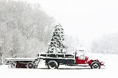 image of covered wagon  - A snow covered truck sits in a field during the Christmas holiday season - JPG