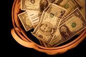 foto of tithe  - a basket with money from the offering at a church - JPG