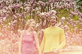 Spring, Nature, Environment. Man And Woman In Spring, Easter. Sensual Woman And Man In Magnolia Bloo poster