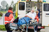 stock photo of oxygen  - Oxygen mask male patient ambulance stretcher emergency transport hospital - JPG