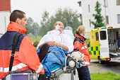 image of stretcher  - Paramedics with patient on emergency stretcher ambulance aid woman man - JPG