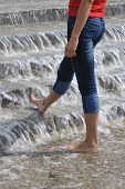 Svelte Woman's Legs In Water Cascade
