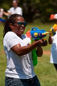 Woman Squirts Competitors In Water Gun Fight