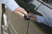 Man's Hand Unlocking Car Door.