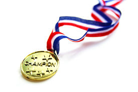 """stock photo of gold medal  - \""""champion\"""" gold medal and ribbon closeup on white ** Note: Shallow depth of field - JPG"""