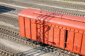 image of railroad yard  - Red freight car in shunting yard  - JPG