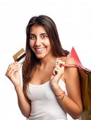 young woman holding credit card and bags isolated on white background