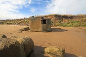 image of emplacements  - ruined gun emplacement on Fraisthorpe beach - JPG