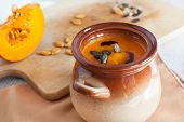 Pumpkin Vegetable Cream Soup In Brown Bowl With Piece Pumpkin