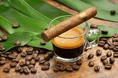 picture of tobacco leaf  - coffee cup and cigar coffee beans and leaves on wooden background - JPG