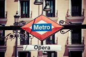 Metro Sign On Blurred City, Madrid