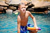 Boy Getting Out Of Swimming Pool