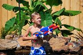 Young Boy With Water Gun