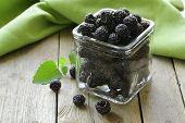 organic ripe black berry raspberry (blackberry) on a wooden table