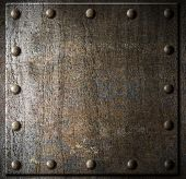 image of plaque  - metal background with rivets - JPG