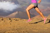 Running sport fitness woman. Closeup of female legs and shoes in action. Girl athlete fitness runner