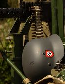 foto of swastika  - German army helmet with swastika and machine gun - JPG