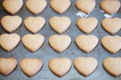 Horizontal Rows Of Heart Shapes Cookies On Baking Tray