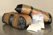 pic of drug dealer  - Packages of  narcotics on gray background - JPG