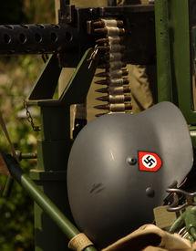 picture of swastika  - German army helmet with swastika and machine gun - JPG