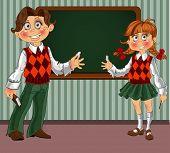 Schoolgirl And Schoolboy With A Blackboard On Classroom
