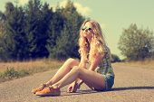 Trendy Hipster Girl Sitting on the Road