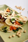 Tortilla wrap with hummus and vegetables