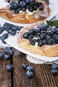 stock photo of tarts  - Blueberry Tart with fresh fruits on vintage wooden background - JPG