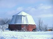 picture of octagon  - Octagonal red barn against blue sky in winter