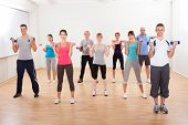 Aerobics Class Working Out With Dumbbells
