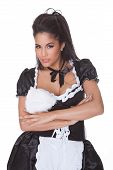 pic of skimpy  - Beautiful sensual woman posing in a skimpy maids uniform with miniskirt on a white background - JPG
