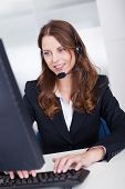 Smiling Receptionist Or Call Centre Worker