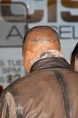 Jamie Foxx's tattoo at the Los Angeles Premiere of 'Law Abiding Citizen'. Grauman's Chinese Theatre,